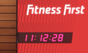 Wharton 4010 digital clock with red display in Fitness First reception area