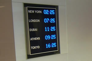 International time zone wall clock with blue display