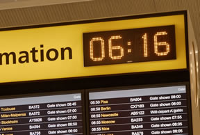 Wharton clock built into Heathrow airport flight information display